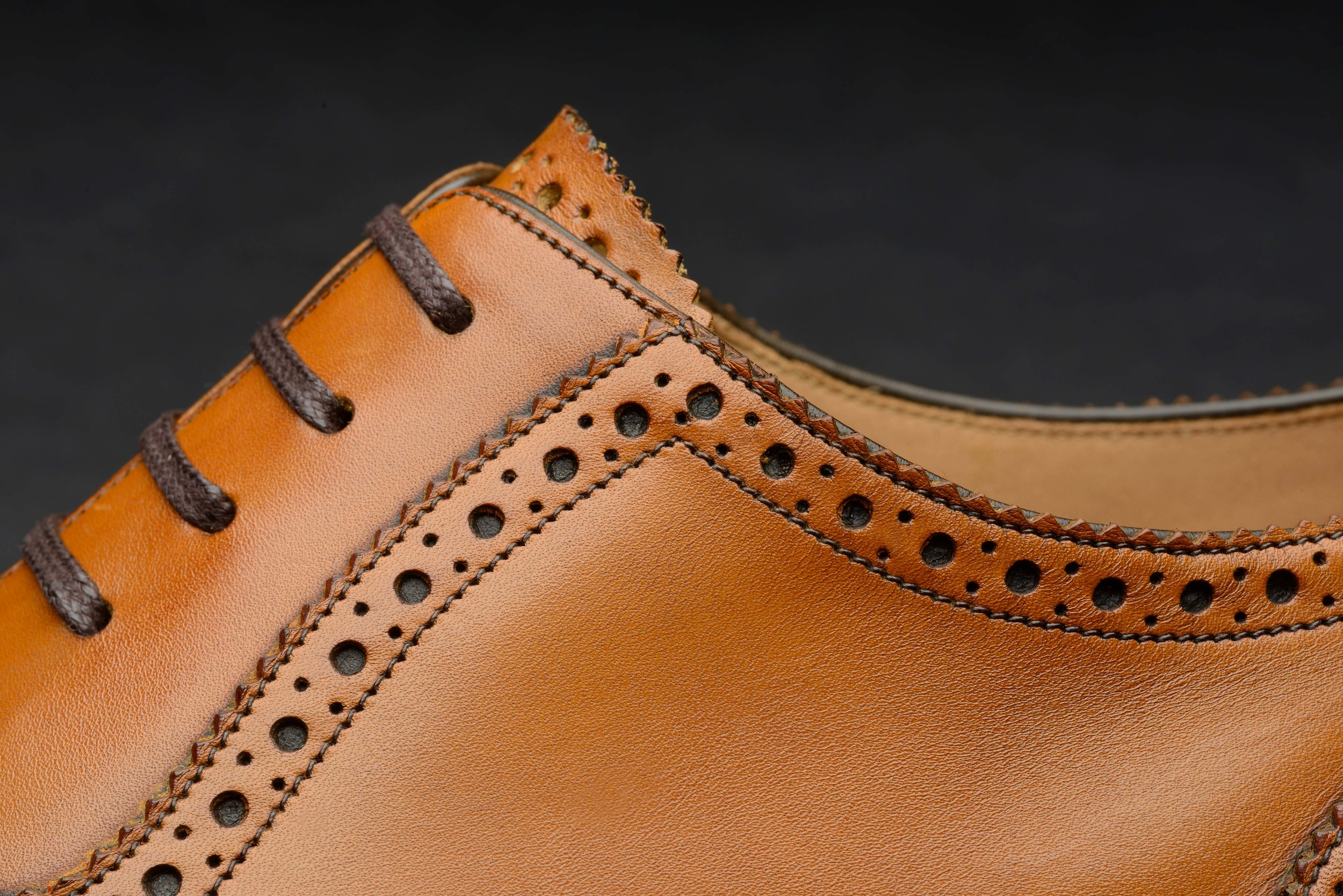 The brogue's punched detailing first created for wear in boggy terrain.