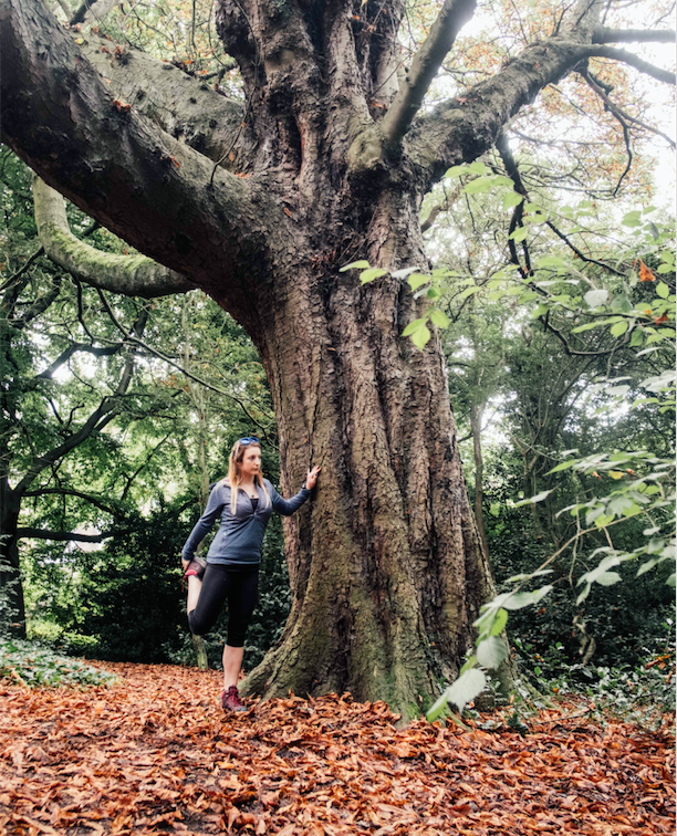 Laura makes use of natural features  , such as trees, for stretching and warming up against