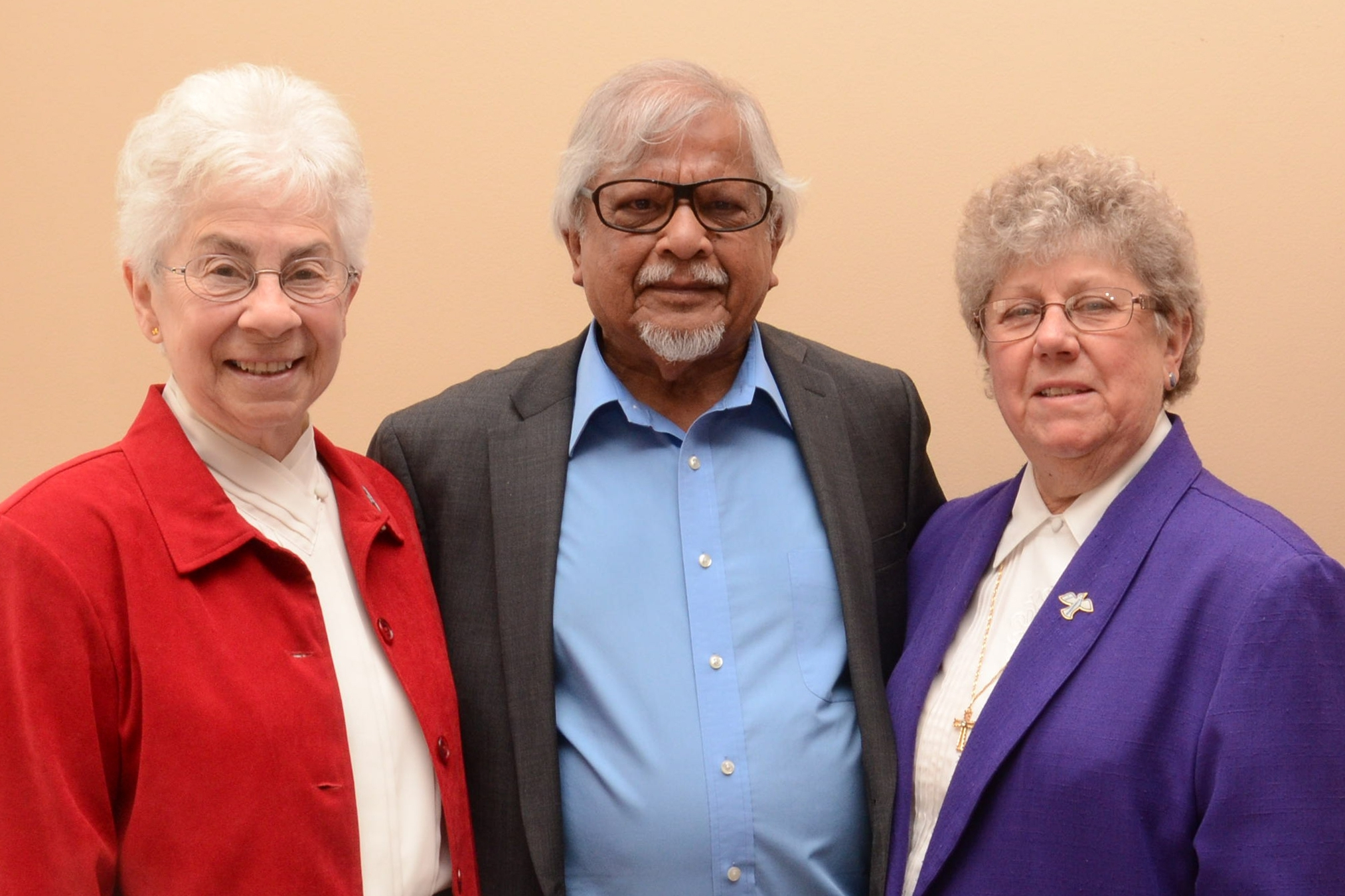 Sisters Mary Jo Colucci, SSJ and Michele Beiter, SSJ with Arun Gandhi