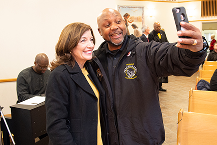 Peacemaker Lenny Lane poses with Kathy Hochul