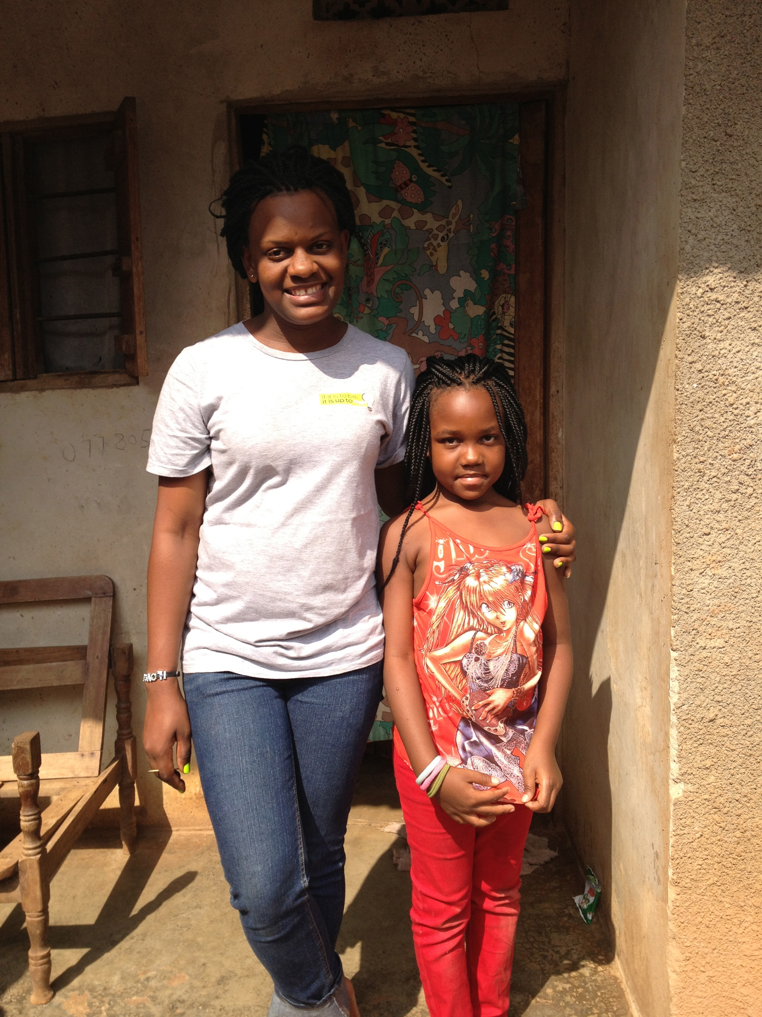 Maureen, one of Empower African Children's University scholars, sets an example for her young cousin.