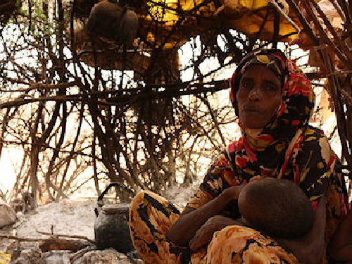 Halima Bare with one of her children, East Africa  Photo courtesy of: Oxfam East Africa http://creativecommons.org/licenses/by/2.0), via Wikimedia Commons.
