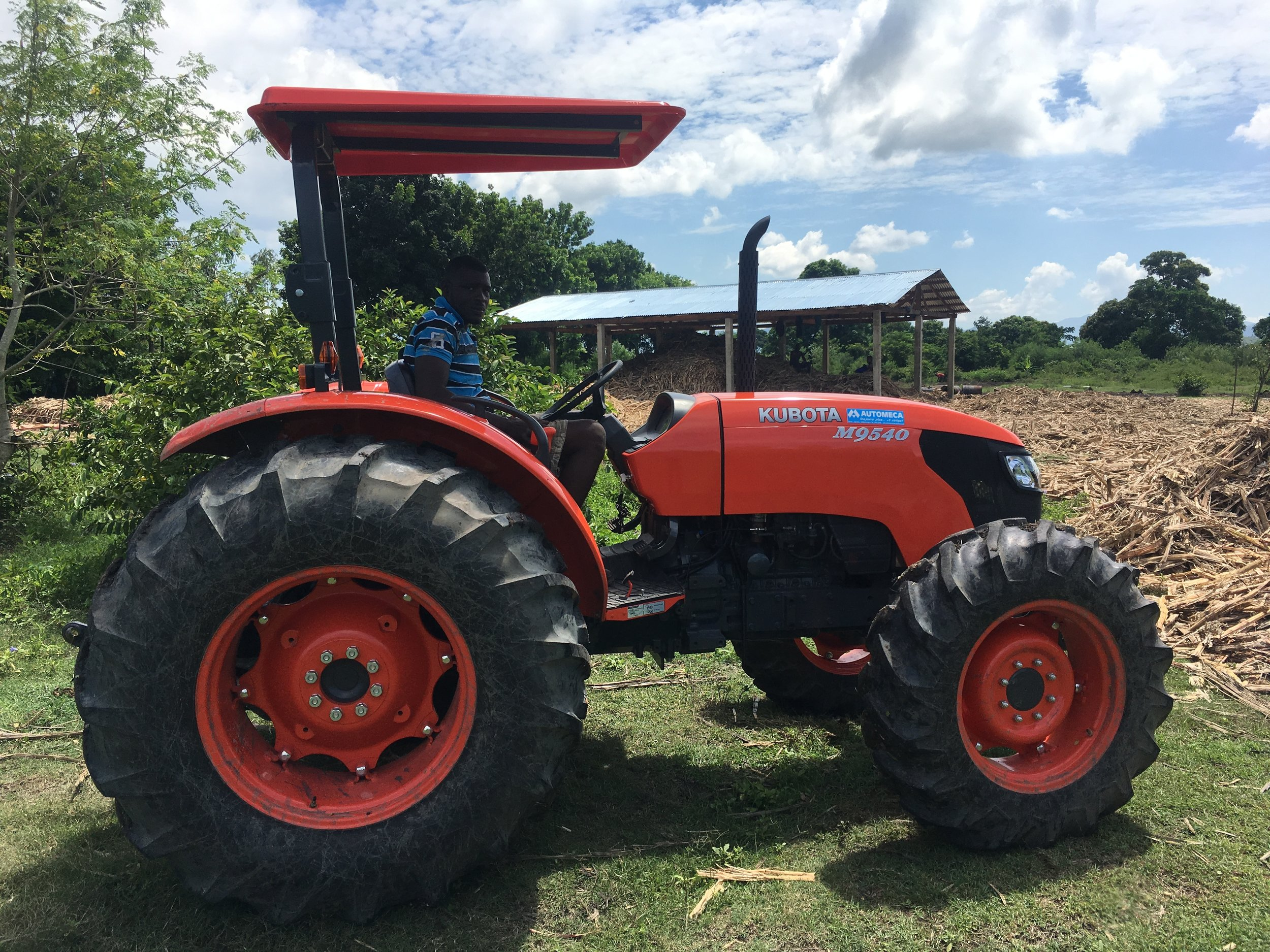 A new tractor; a purchase made possible with our loan.