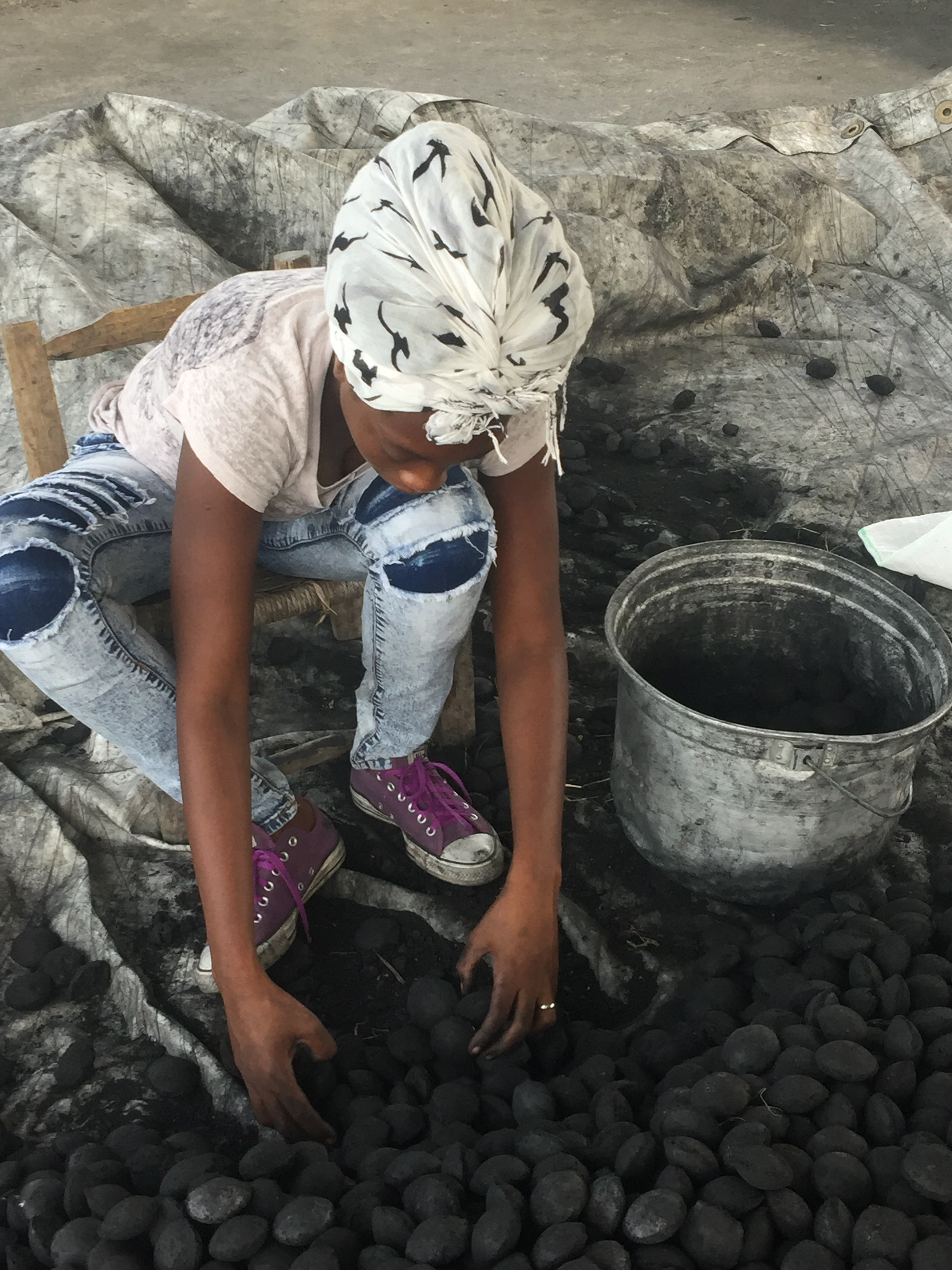8. The charcoal mixture is pressed into briquettes and dried until hard and durable.