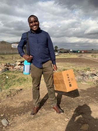 A new KOKO Fuel customer heading home with his new KOKO Cooker & reusable canister
