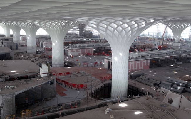 The columns and ceiling by Formglas in the Mumbai airport suggests a peacock, India's national bird.
