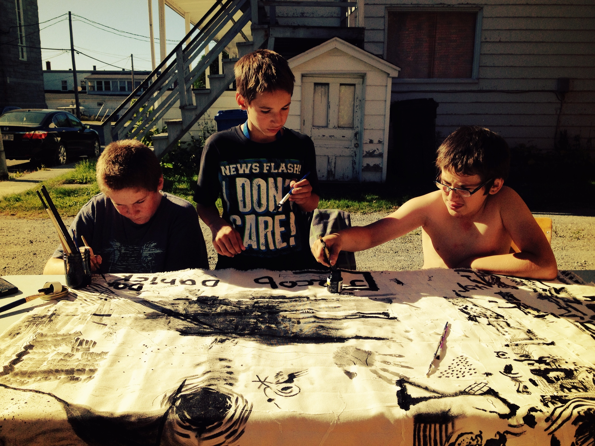 Three kids painting