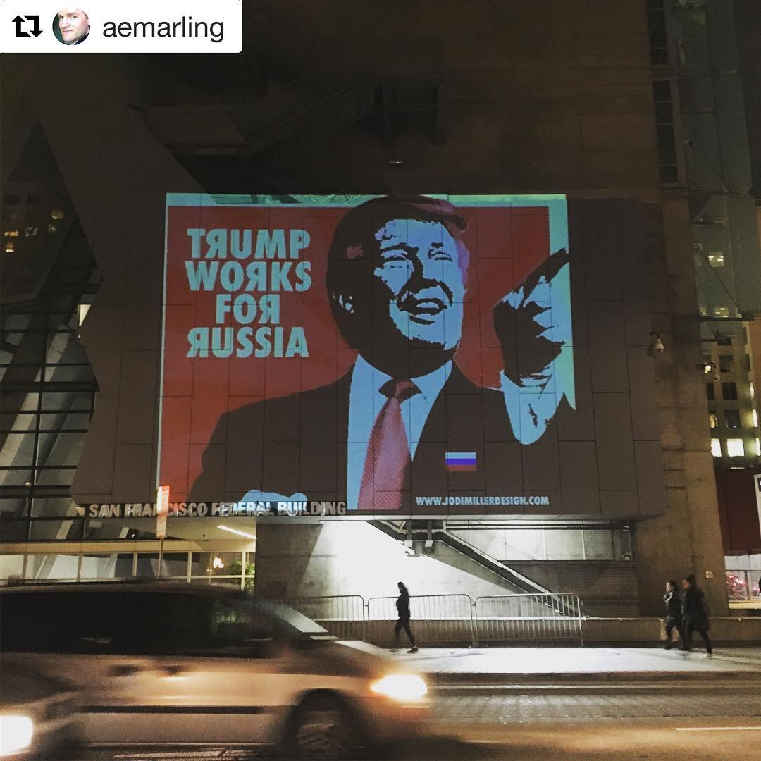 Meme projected onto the SF Federal Building.