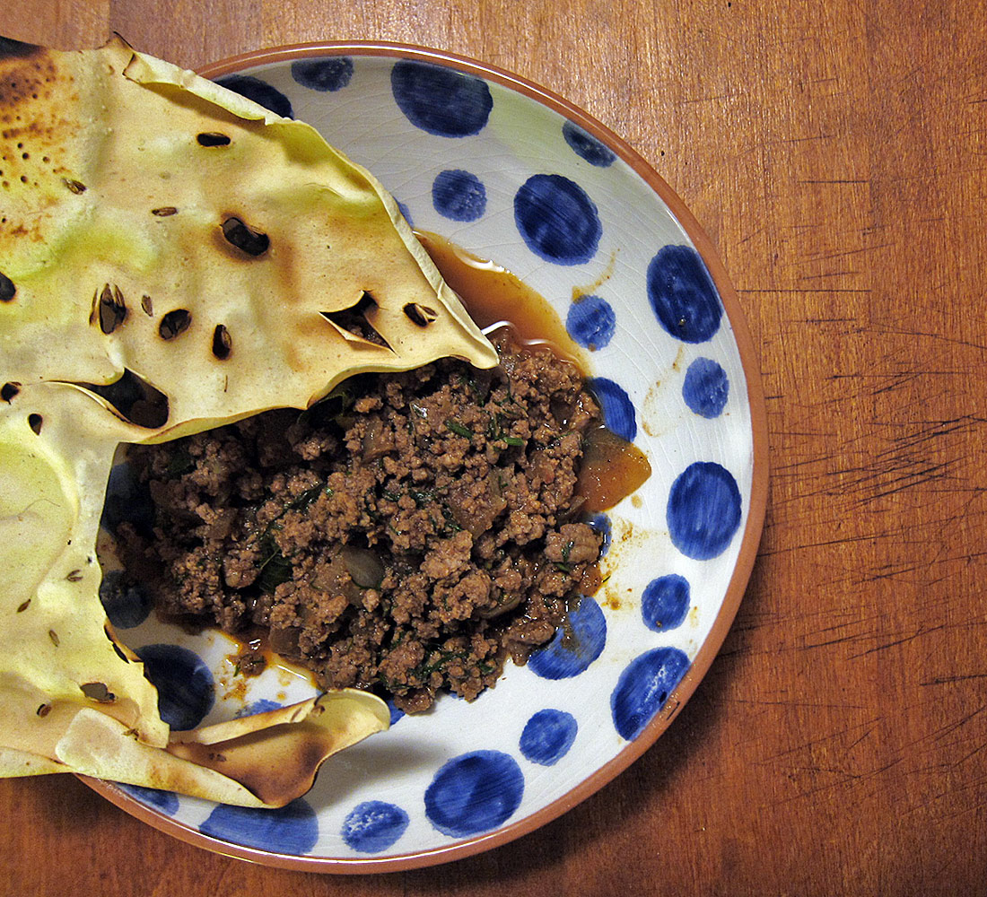 A papad, if you have any, is a great edible scoop