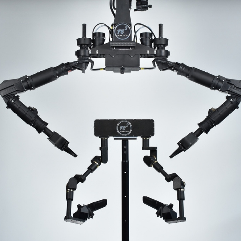 RE2's Imitative Controller (bottom) which intuitively controls the Highly Dexterous Manipulation System dual robotic arms (top).