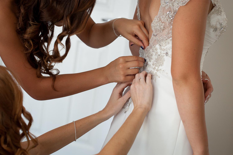 Tying up the wedding dress.