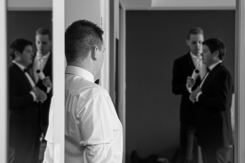 Dusting down the groom.