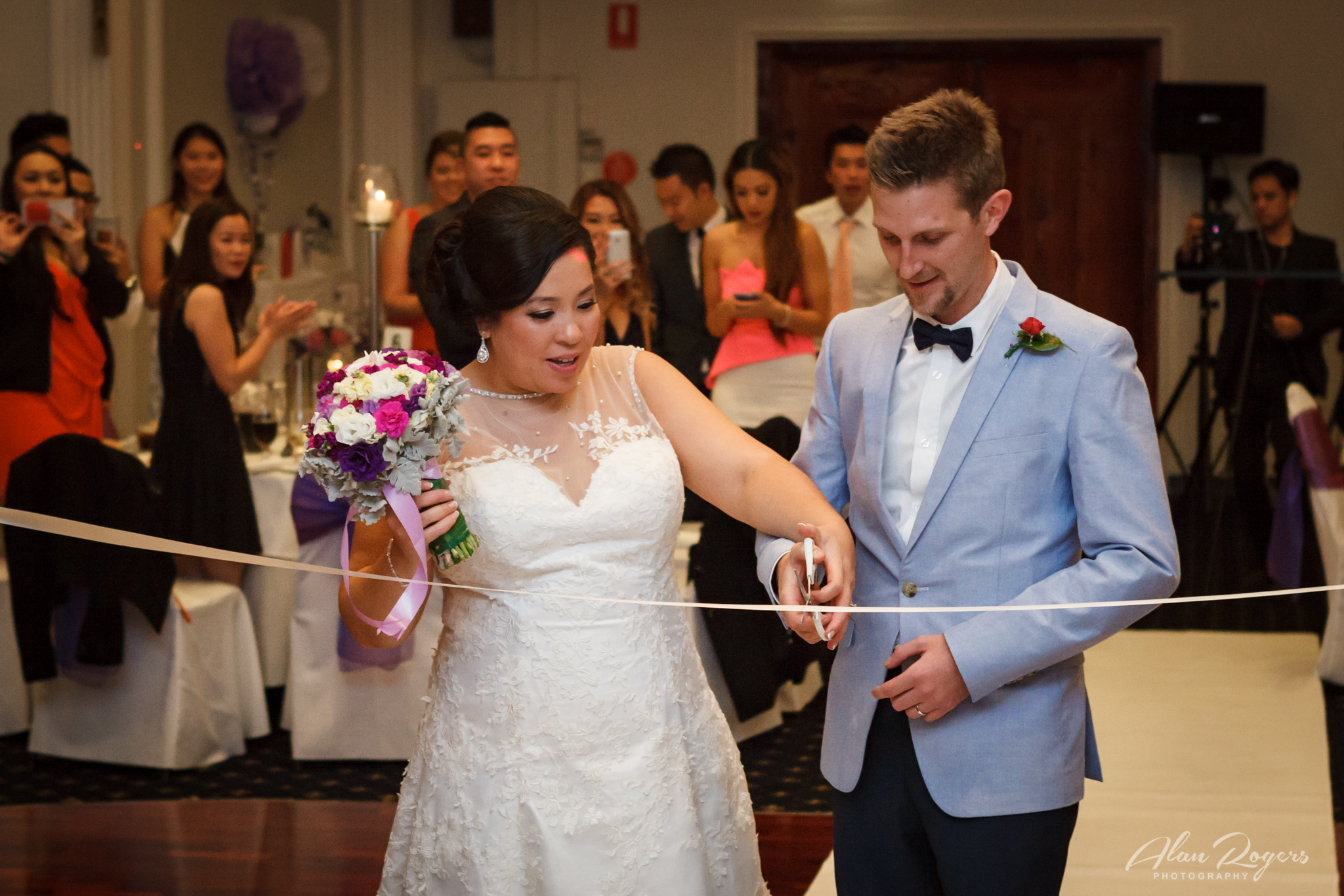 bride-groom-ribbon-cutting.jpg