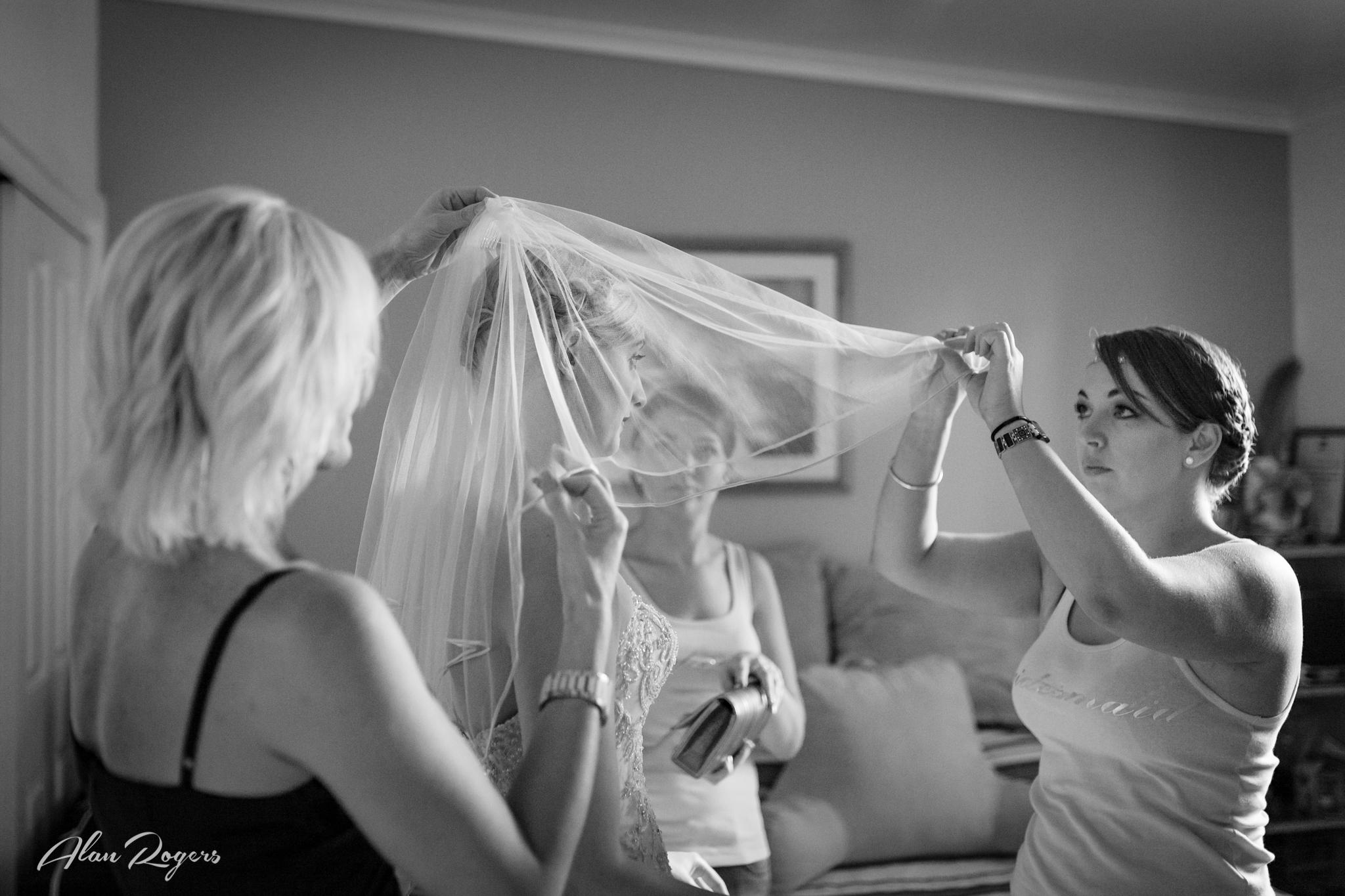 Adjusting the veil.