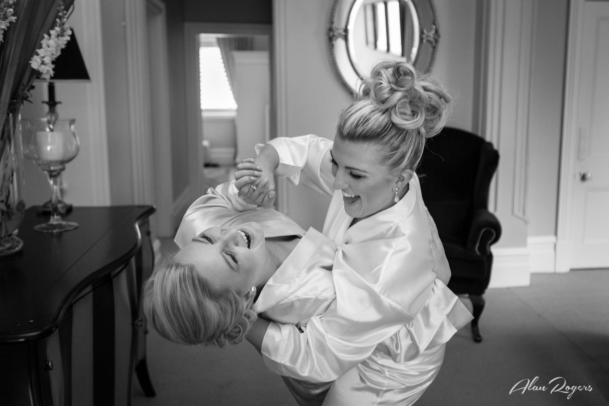 Bride and sister playing.