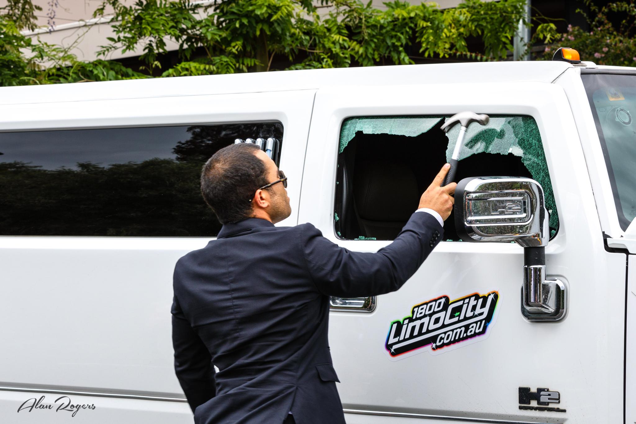 breaking-the-limo-window.jpg