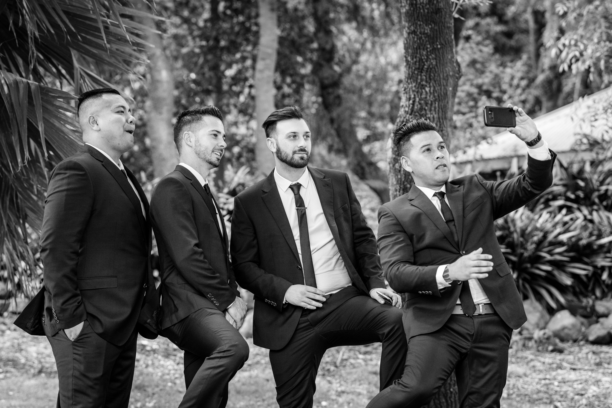Groomsmen take time out for a Selfie.