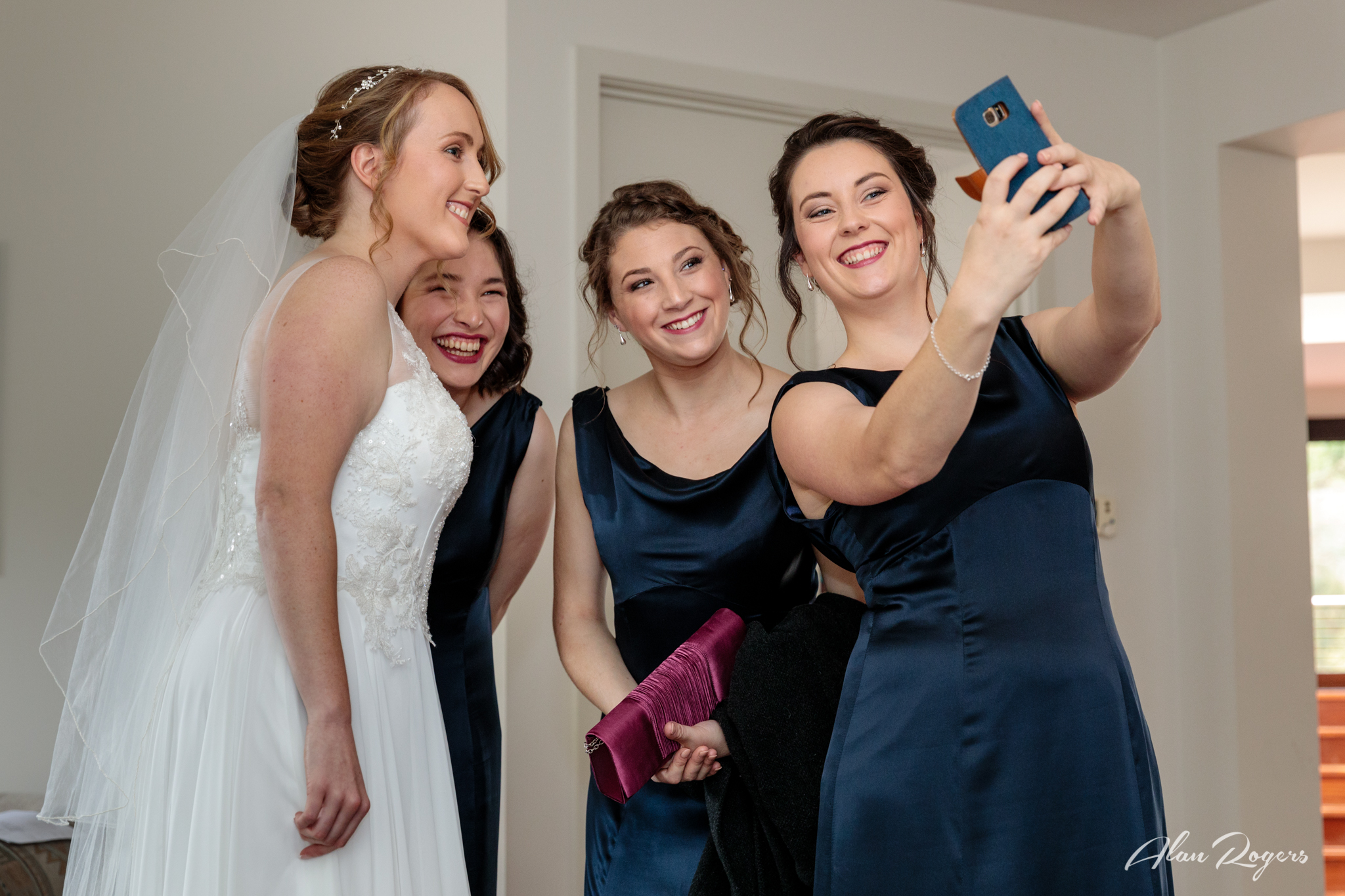 Bride and her Bridesmaids take a selfie before heading off to the church.