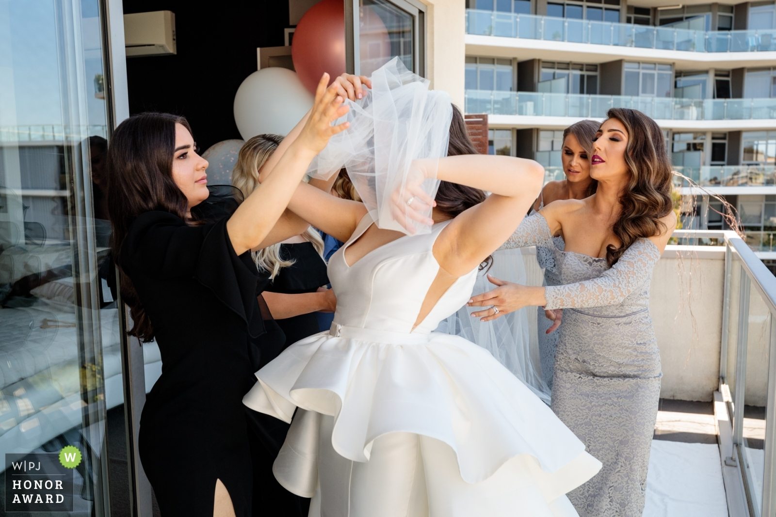 bridesmaids-helping-with-the-veil