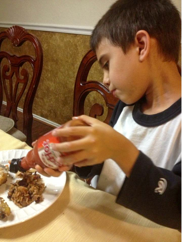 Joaquin applying hot sauce to his food. This man knows no fear.