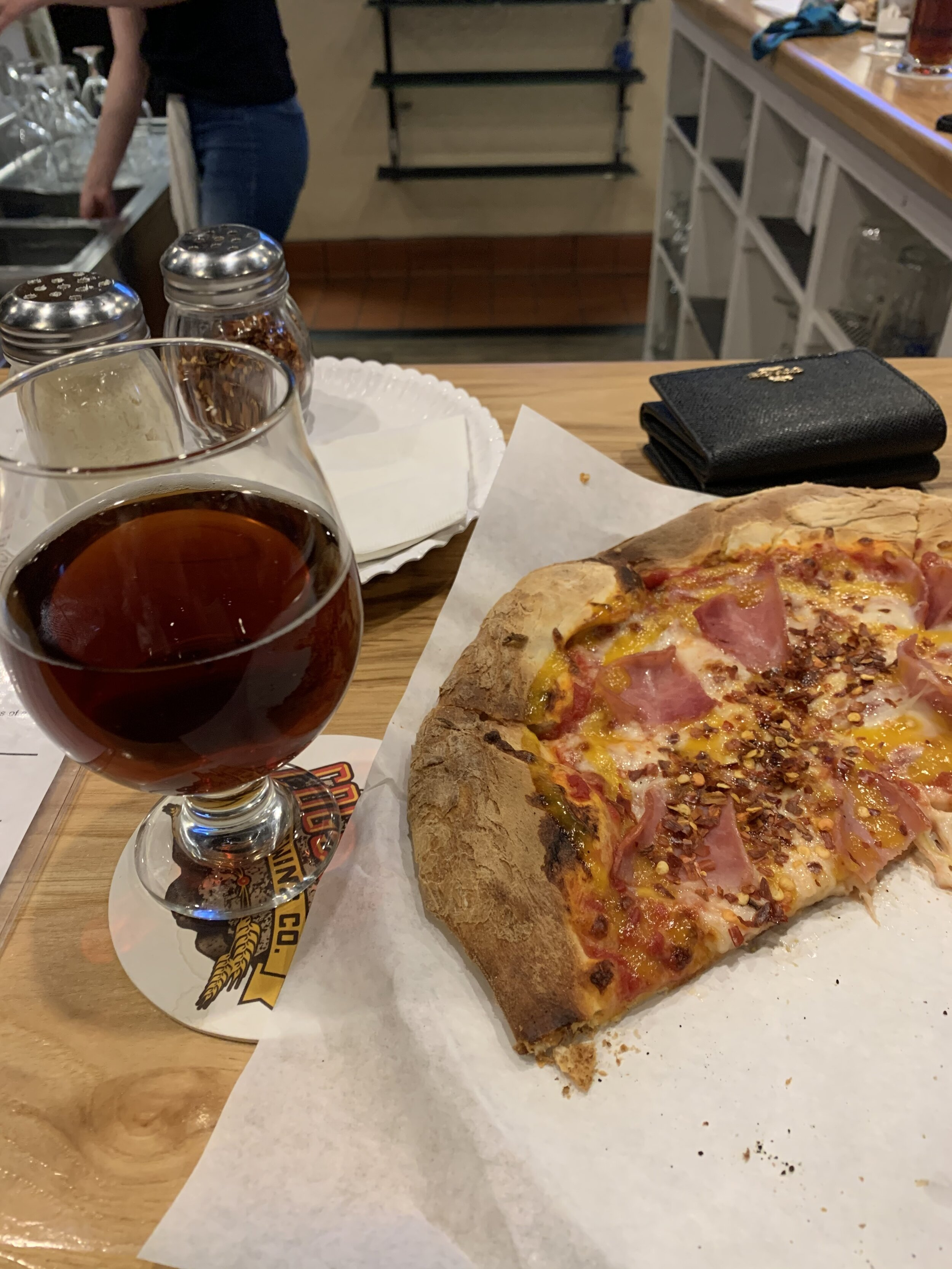 Pizza from Cogstone Brewing. Don't mind the chili flakes… that's my weird touch. Pictured is the Pumpkin Ale.