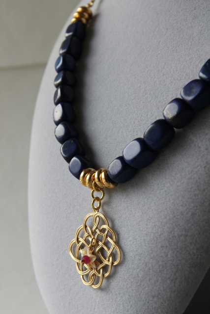 Midnight in the Garden (lapis lazuli, ruby, handcarved shell, gold plated brass, brass)