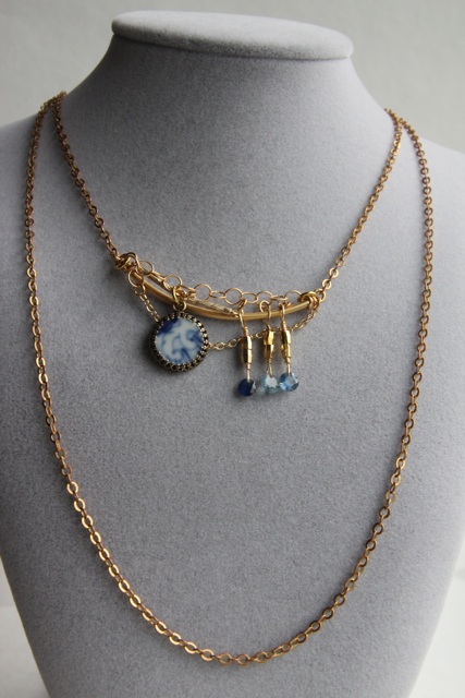 China Doll (sapphires [1.5 carats total], Qing porcelain fragment, gold plated brass, brass)
