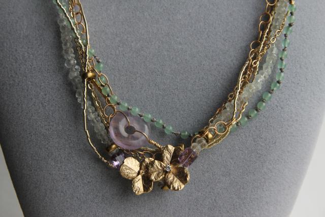 On Golden Pond (amethyst, aquamarine, jade, cubic zirconia, gold plated brass, silver thread, brass)