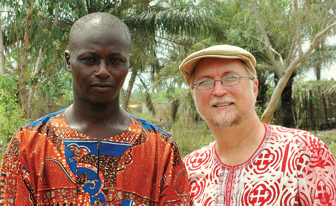 """Mike and Lynn Hutchinson help people in their community to discover their gifts, passions and assets that can lead to sustainable projects that lift them out of poverty and empower them to """"be who God designed them to be."""" Mike (right) is pictured with a local pastor, Dominique (left), who shared ideas about how to reach out and impact his community."""