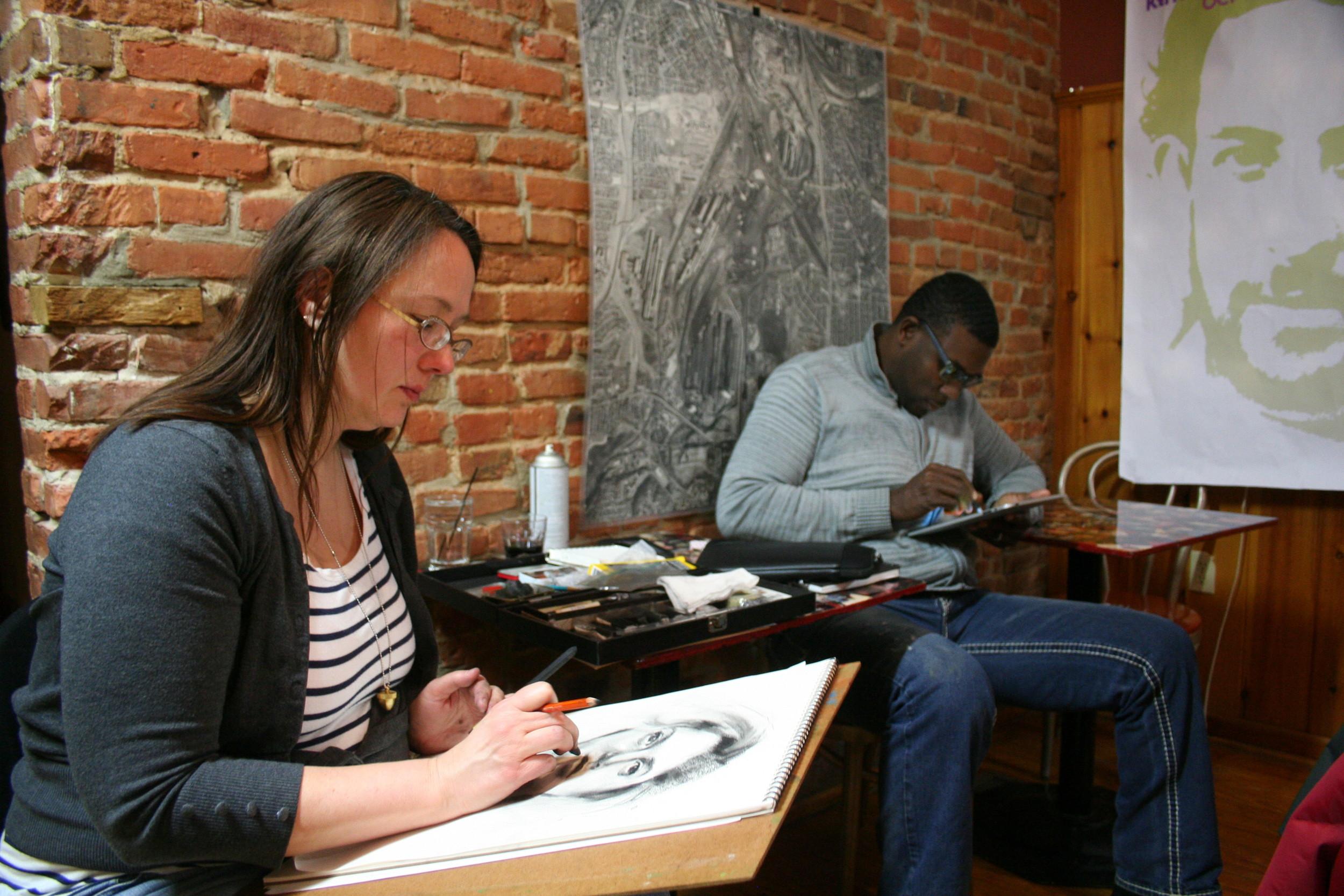 Kathryn Heim and Gus Turner working of their portraits of Ina Basho