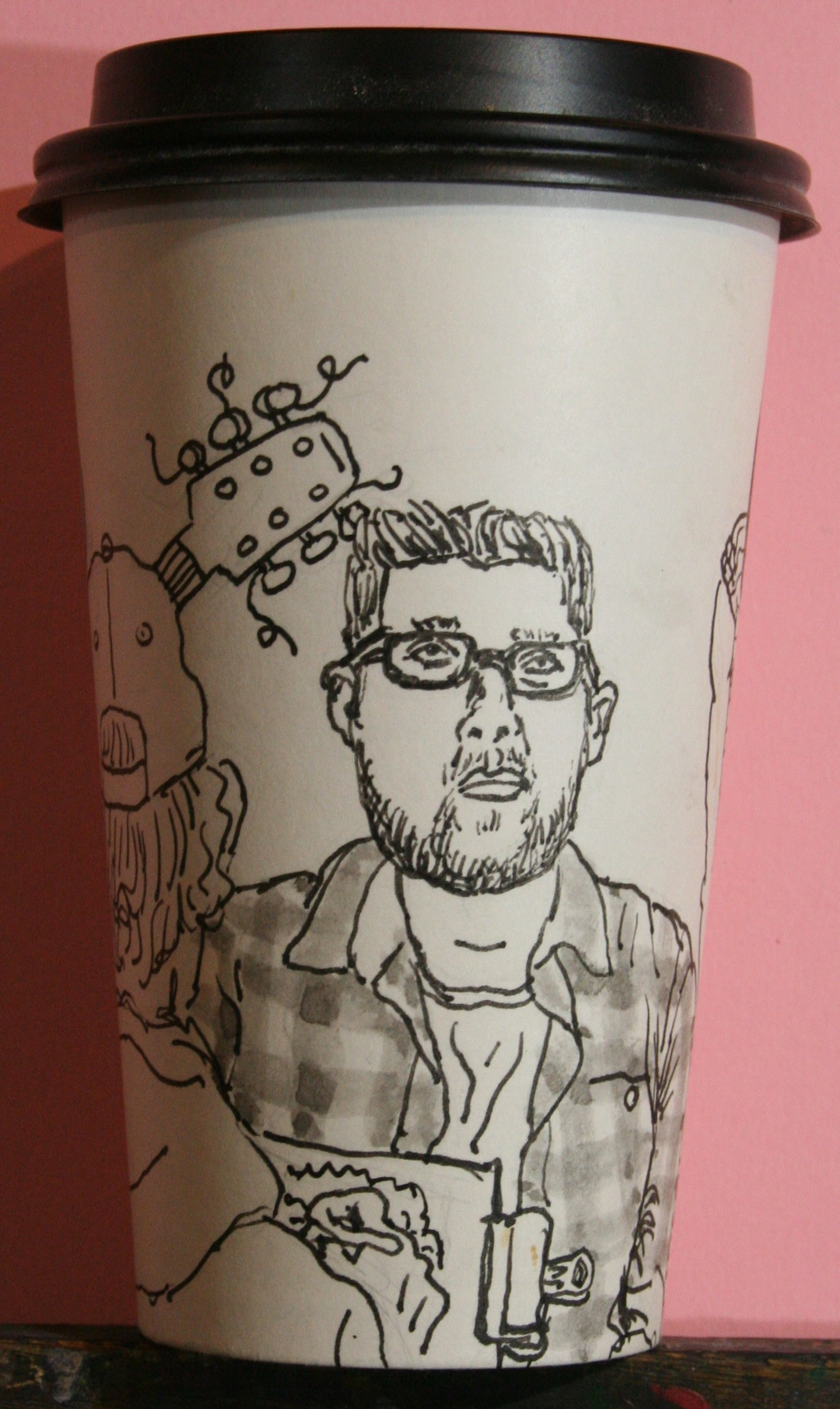 Jack Flotte did this hour and a half coffee cup portrait of Drew.