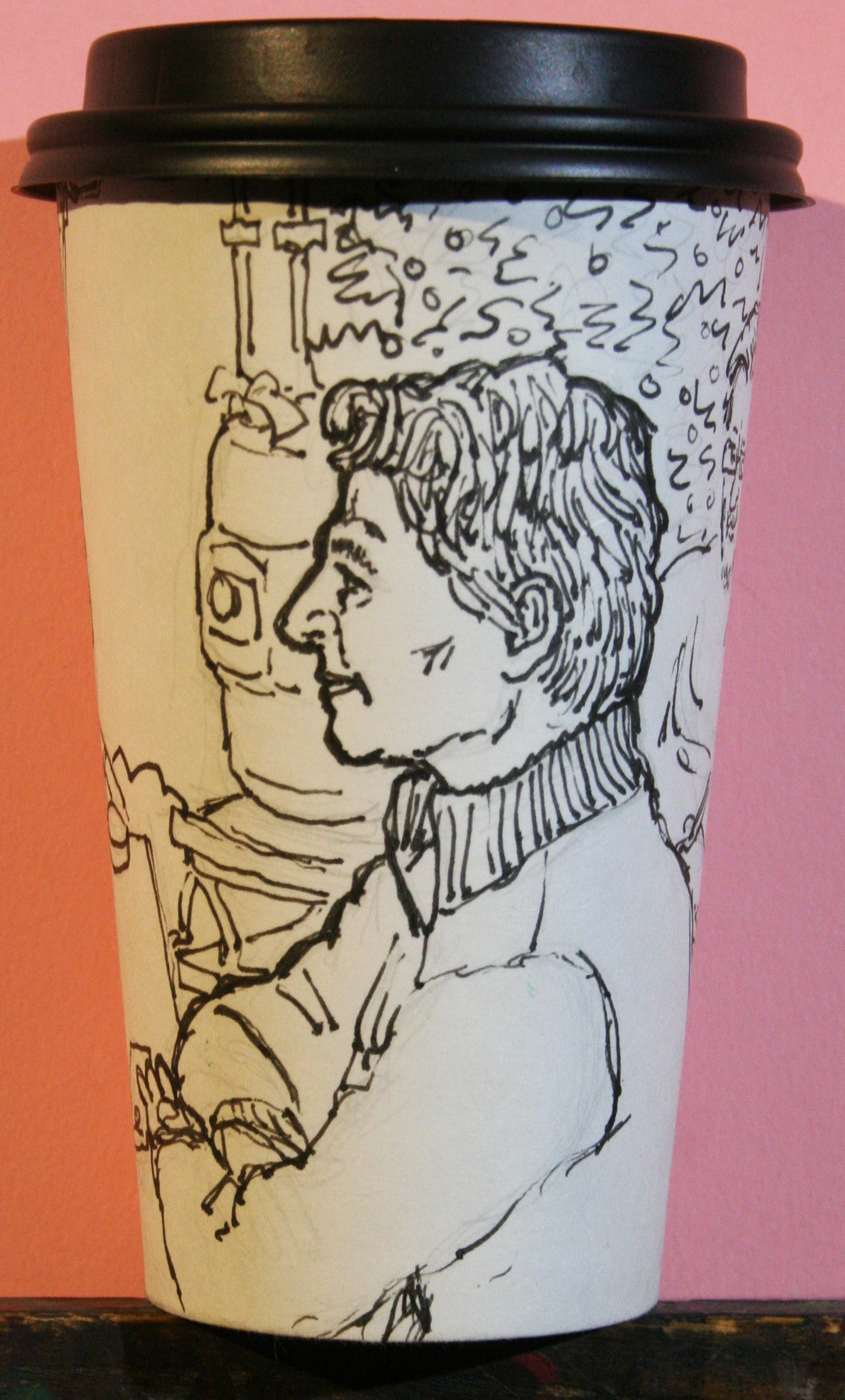 Jack Flotte did this coffee cup portrait.