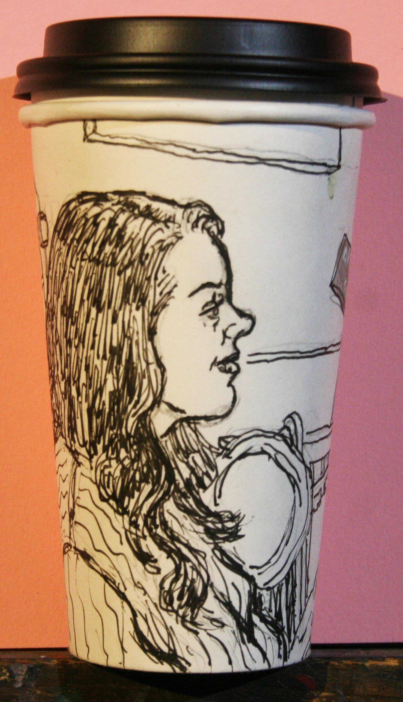 Jack Flotte did this coffee cup portrait of Sara.
