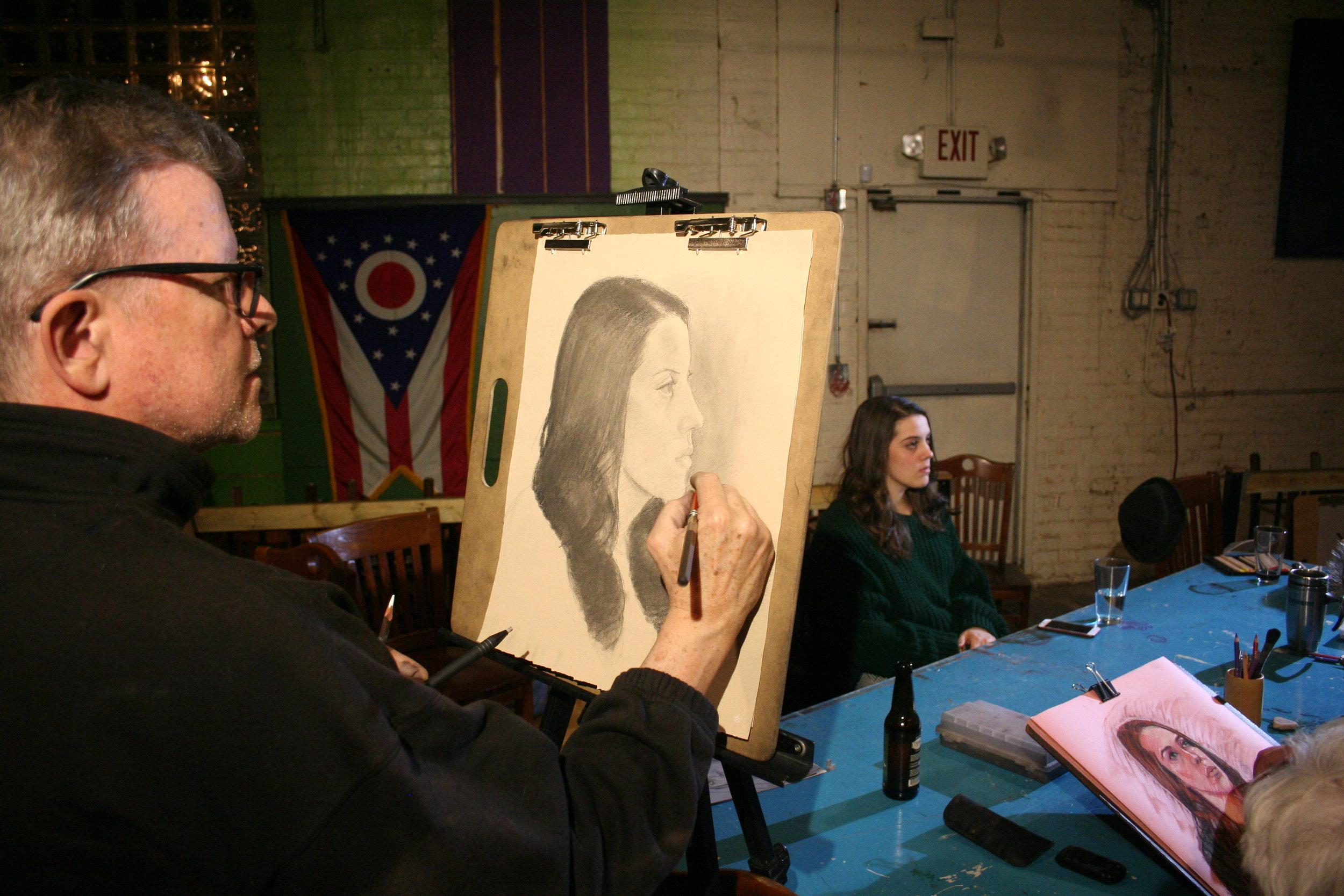 Howard Collier drawing Sara.