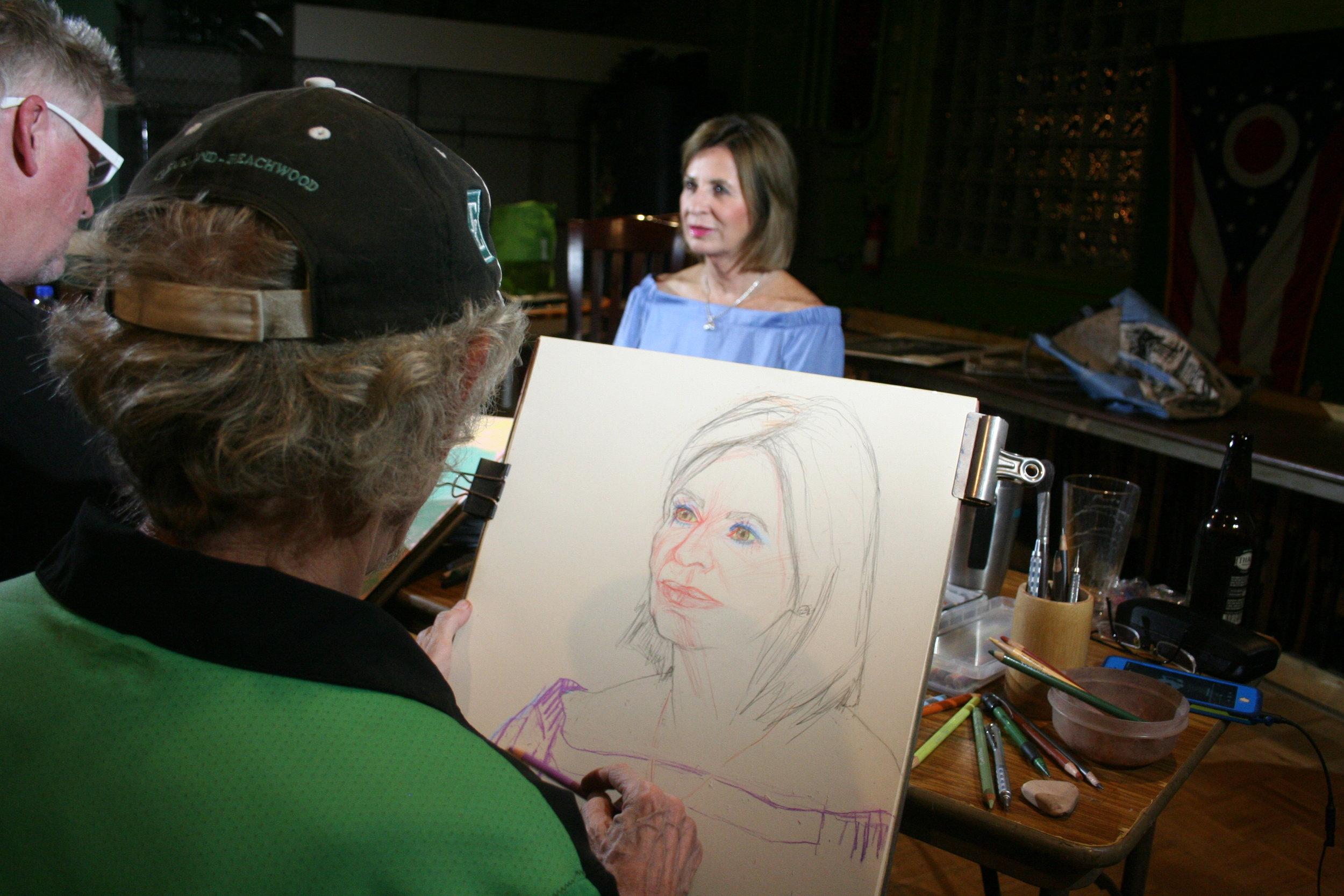 Larry Zuzik drawing Karyn.
