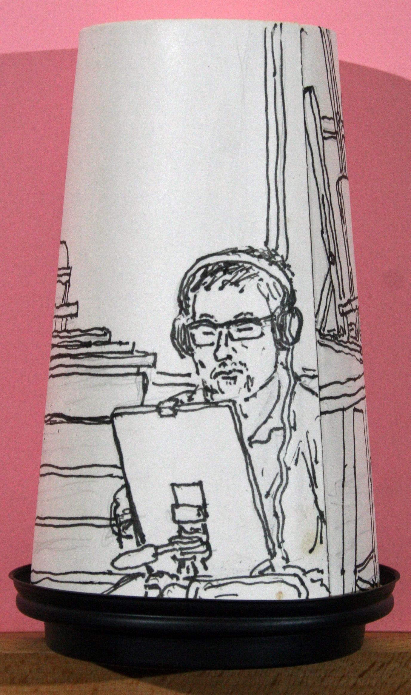 Portrait of Steve Sens on the back of Jack Flotte's coffee cup portrait of Arnette.