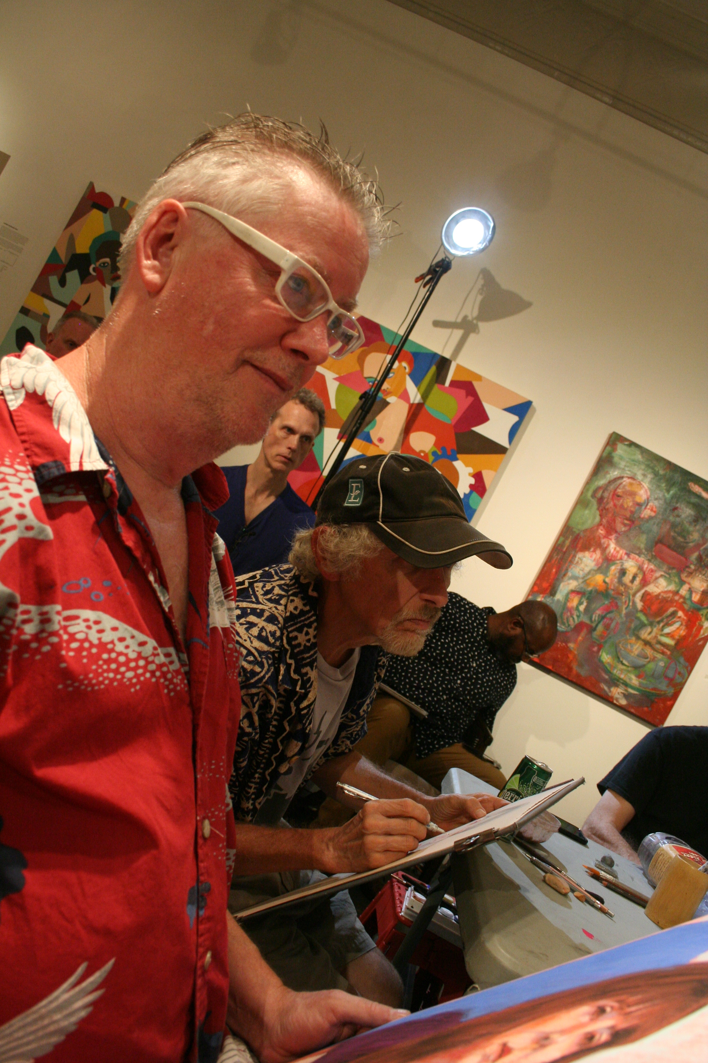 Timothy Herron, Larry Zuzik and Anthony J. Robinson drawing Kari.