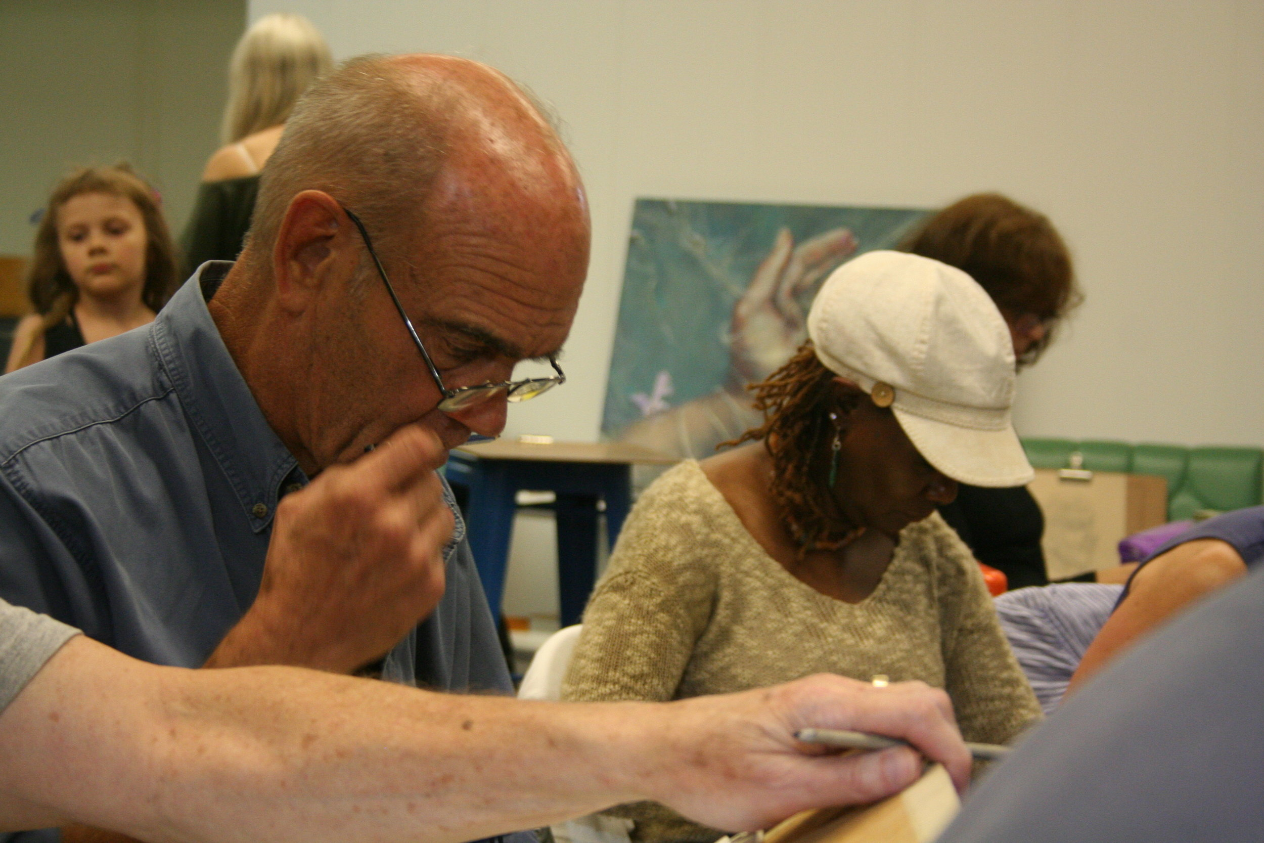 Bob Eggers and Linda Sue Morris working on their drawings.