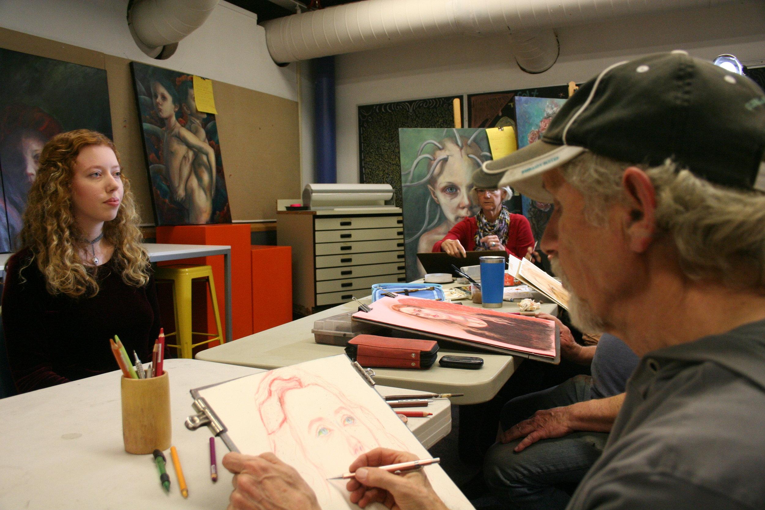 Larry Zuzik drawing Eliana.