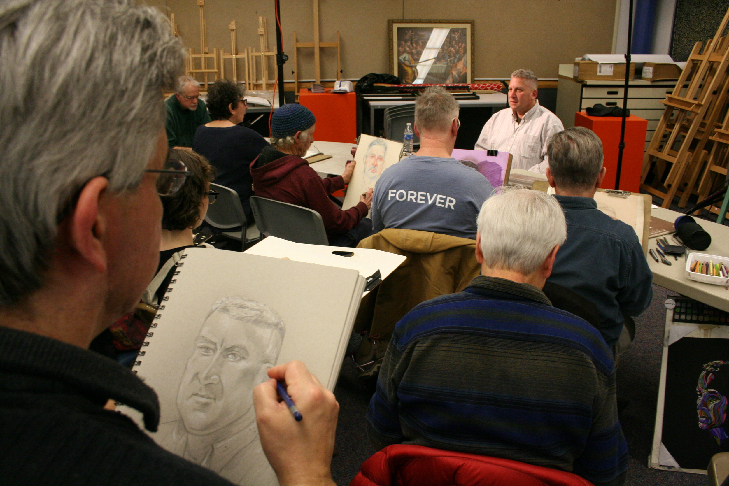 Juan Quirarte drawing Jeff. Photo by Brian Pierce.