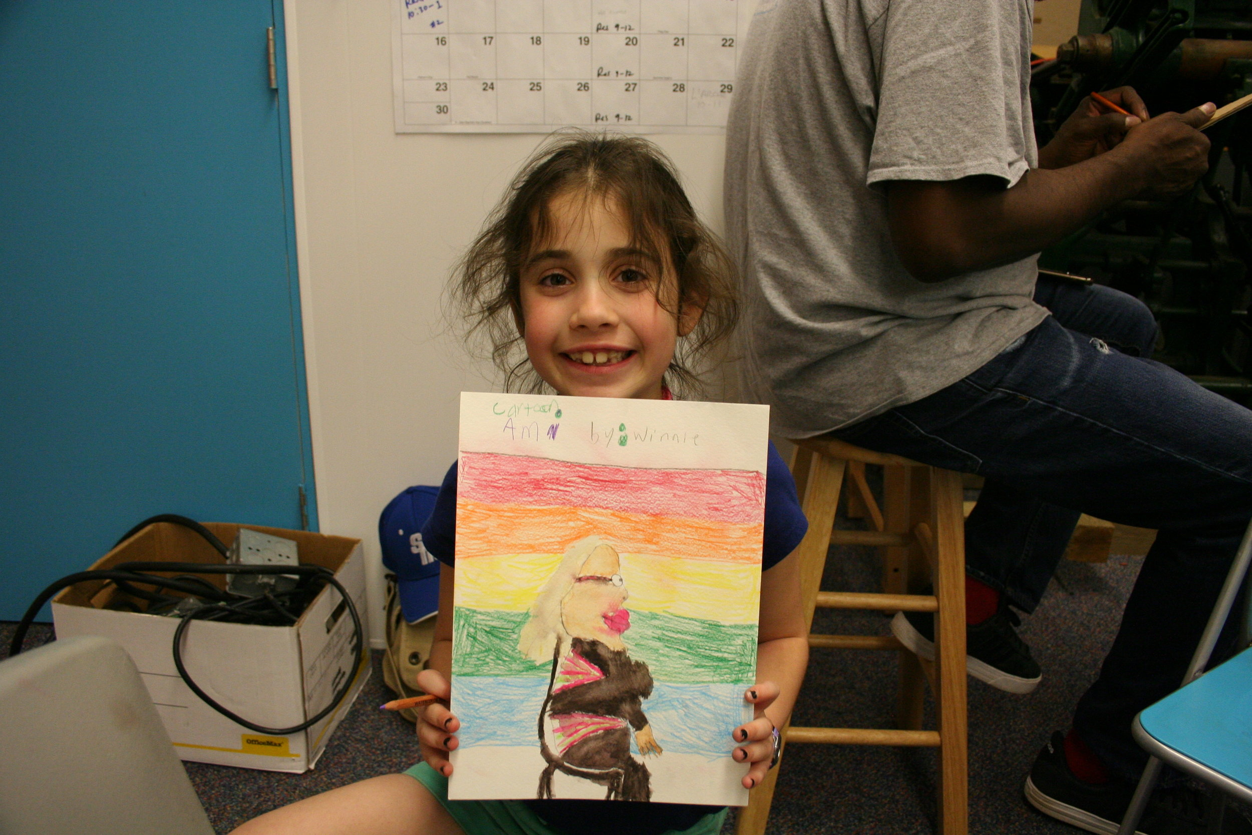Winnie Averre showing of her first place drawing.