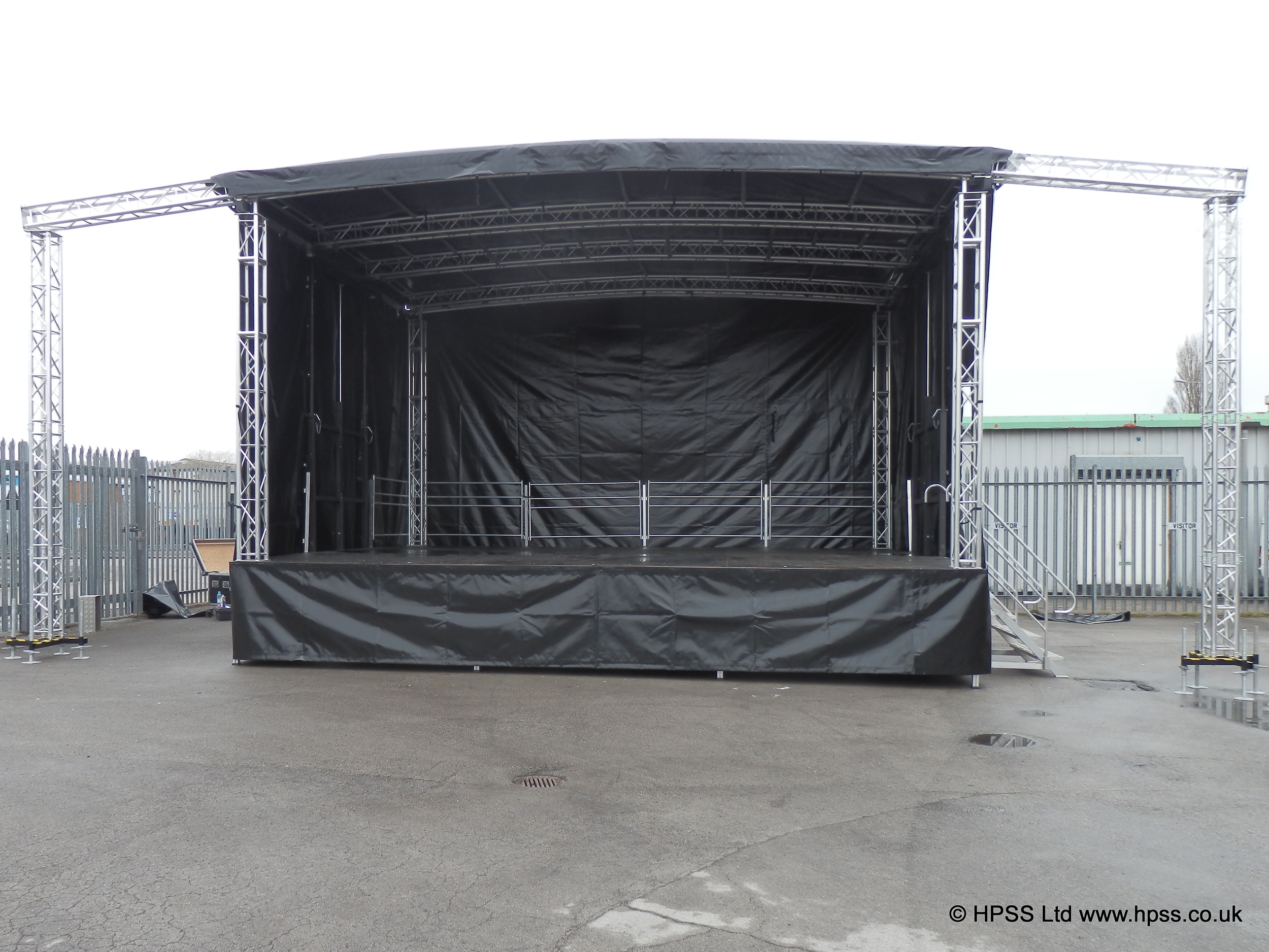 Trailer stage with wings