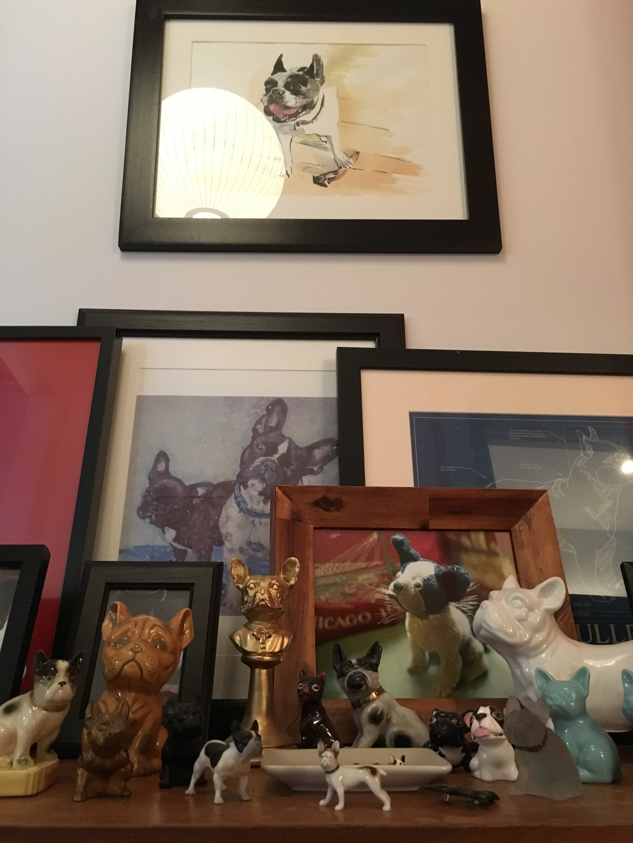 This is the Frenchie Shrine in my house. Most of the artwork and objects are gifts from friends. At the top is a beautiful watercolor portrait of my dear, sweet late Frenchie Prue by Dmitry Samarov. It's not hoarding if it's organized, right?