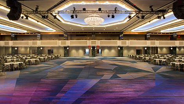 Within one of Manhattan's largest hotels, the  New York Hilton Midtown , is Manhattan's largest hotel ballroom, which features an over-the-top crystal chandelier atop its newly renovated 25,000-square-foot Grand Ballroom.