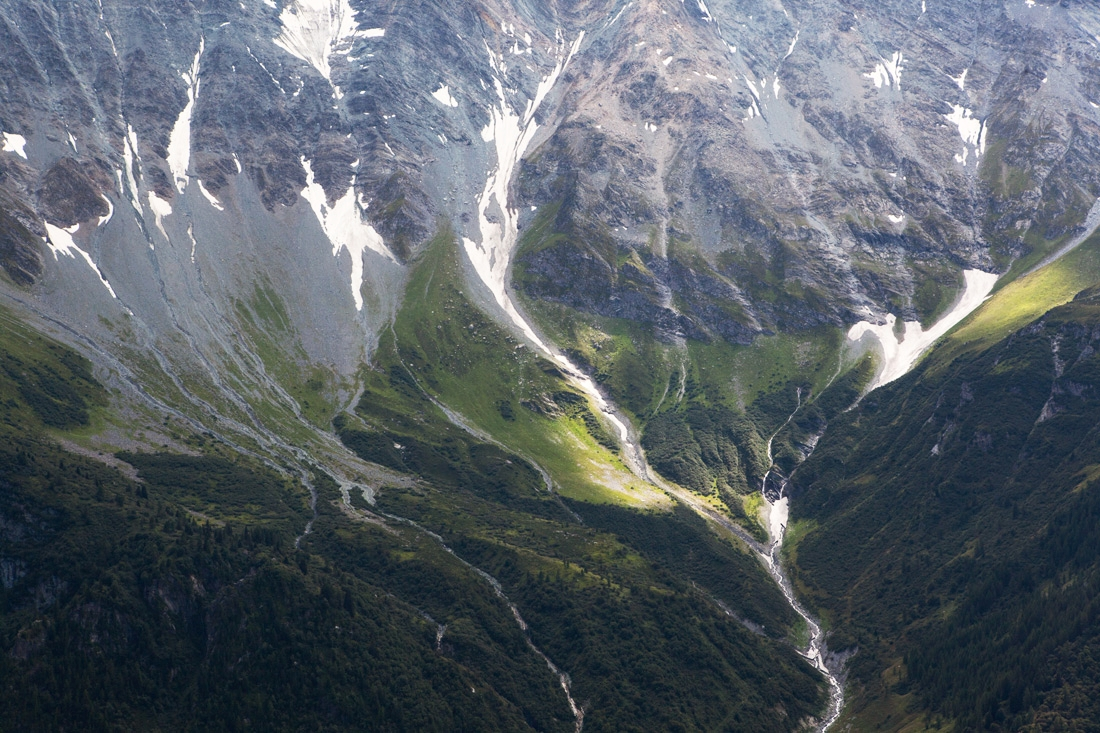 The upper and lower slopes of the Vanoise Massif showing glacial runoff. On certain parts of the mountain slopes water is captured and directed through an underground system of tunnels to feed a reservoir in nearby Tignes.
