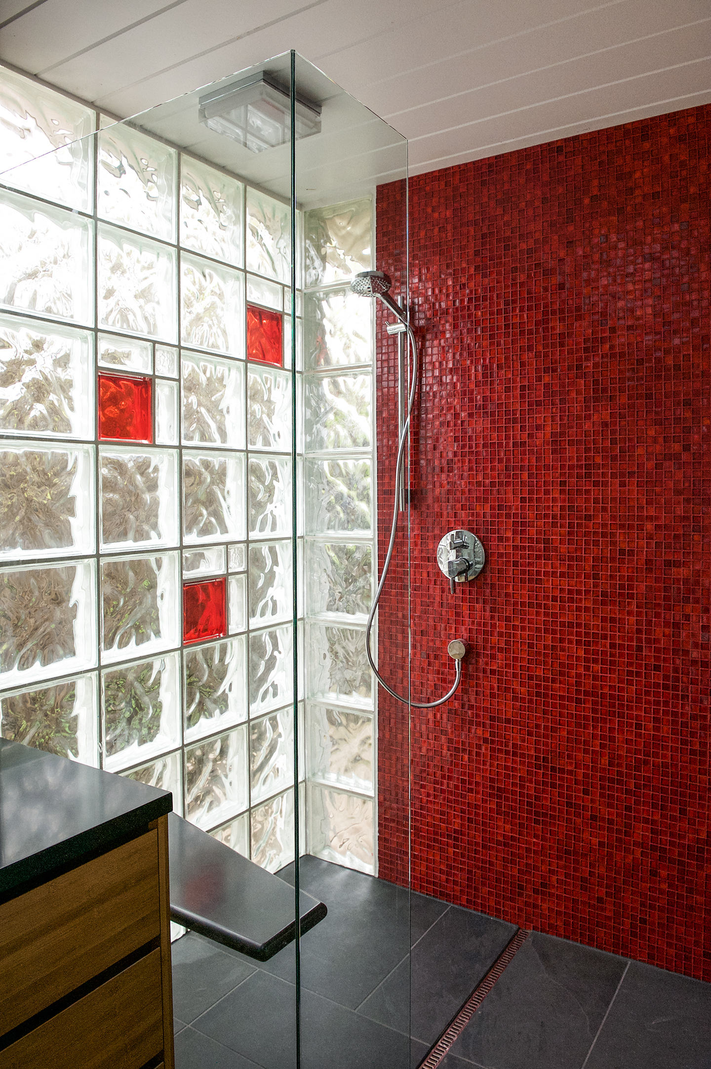 The bold red is also carried through in the master bathroom.