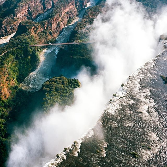 Victoria Falls is the largest sheet of falling water in the world. Here it is shot from a helicopter using a YashicaMat EM and Kodak Portra 160. . . . #victoriafalls #africa #zimbabwe #zambia #waterfalls #mediumformat #arialphotography #helicopterphotography #yashica #yashicamatem #kodakportra #portra160 #tlr #6x6 #squareformat #filmphotography #filmisnotdead