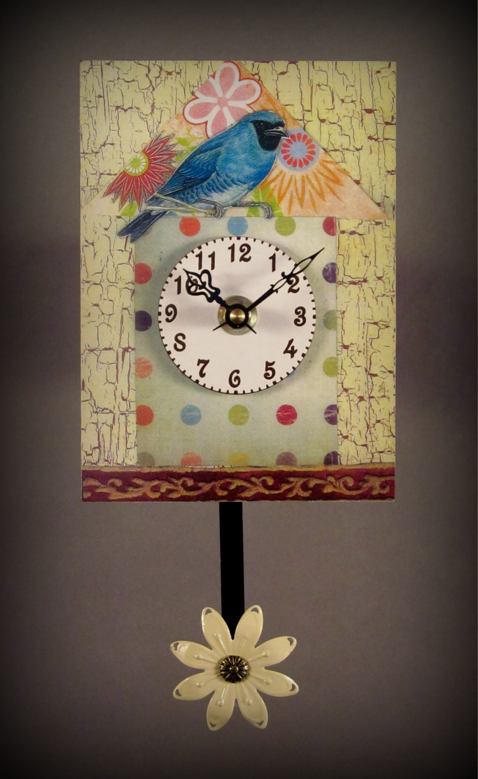 PAPER ART OVER A WOOD BACKING. THIS LITTLE GEM MEASURES 5 X 9 INCHES. IT RUNS ON A SINGLE AA BATTERY. EASY AS CAN BE!