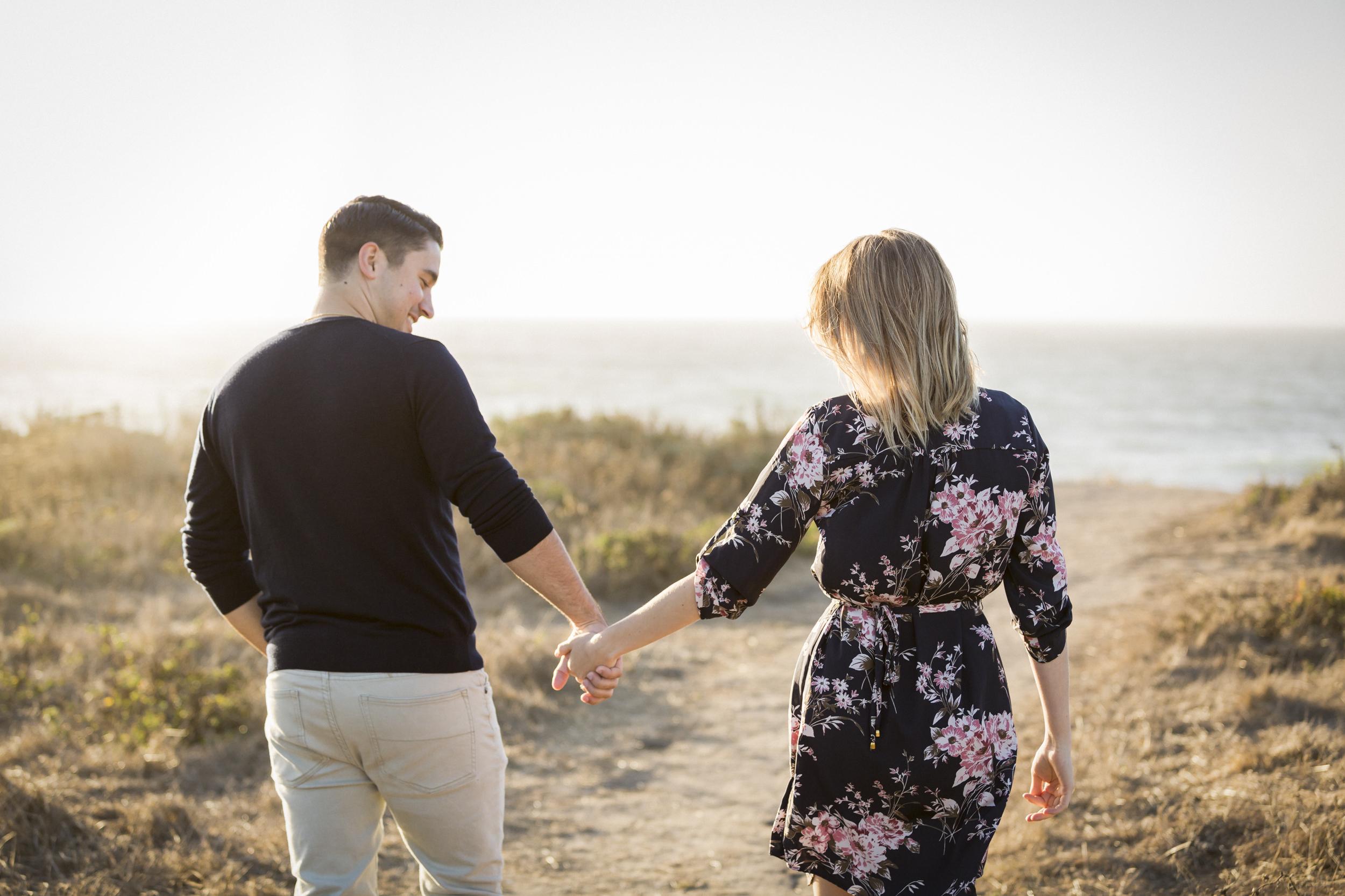 montara-state-beach-engagement-holding-hands-1.jpg