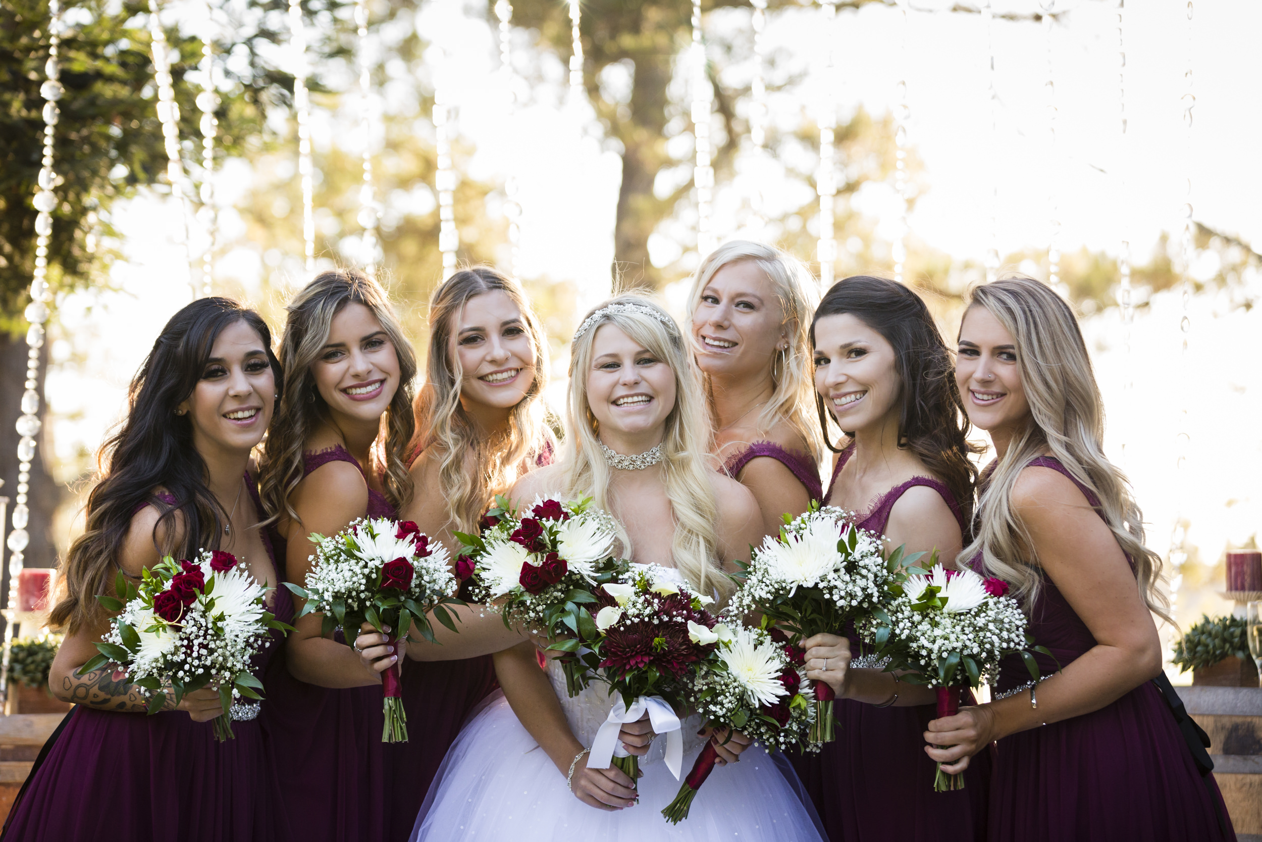 bridal-party-bridesmaids-posing-with-bride-1.jpg
